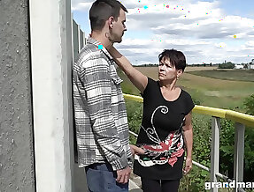 Short haired granny shamelessly gives a blowjob outdoors with the addition of fucks well